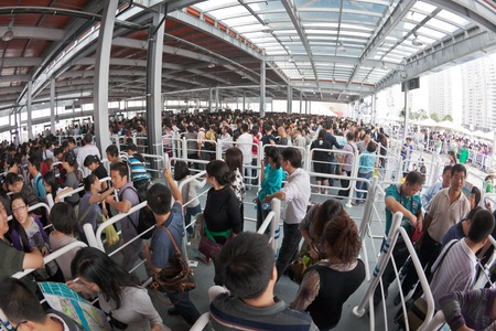 exhibition crowd: Shanghai, China - October 2, 2010: Crowd queuing up outside the entrance of World Expo 2010 in Shanghai, China Editorial