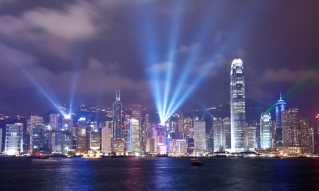 light beams: Beams of light shining up into the sky during Symphony of Lights show in Hong Kong Stock Photo