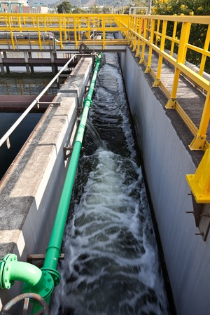 treatment plant: Flowing water in a channel in sewage treatment plant