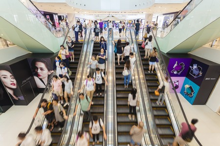 Hong Kong, China - June 2, 2015: People riding on escalators in a busy shopping mall in Hong Kong Publikacyjne