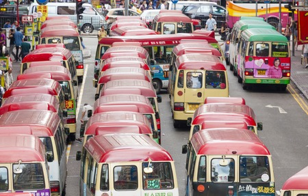 mini car: Hong Kong, China - June 2, 2015: Minibuses lining up, waiting for passengers at a busy station in Mongkok, Hong Kong Editorial