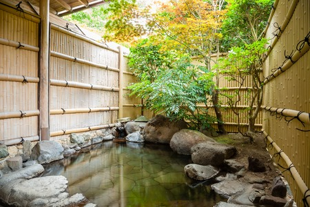 ryokan: Outdoor onsen, japanese hot spring with trees Stock Photo