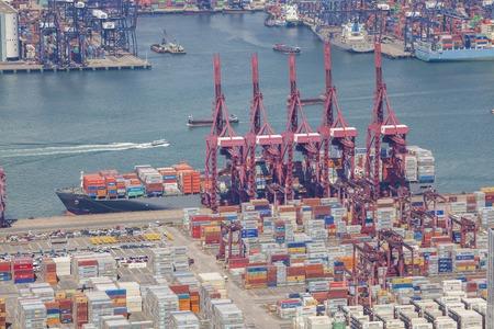 harbors: Hong Kong, China - Jun 15, 2015: Container ship unloading at the Kwai Tsing Container Terminals in Hong Kong
