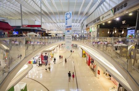 asian shopper: Hong Kong, China - Jun 23, 2015: People visiting a shopping mall in the Hong Kong Internaional Airport