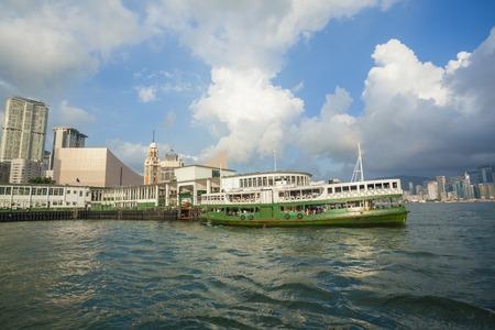 hongkong: Hong Kong, China - May 30, 2015: A ferry leaving the pier in Tsim Shai Tsui and sailign across Victoria Harbour in Hong Kong