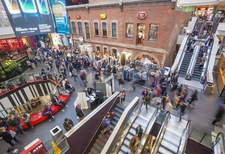 mall: Melbourne, Australia - Aug 1, 2015: People visiting Melbourne Central, which is a complex with shopping mall, office tower and railway station. It is a popular tourist attraction in Melbourne, Australia. Editorial
