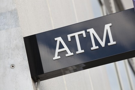 withdraw: Close-up view of an ATM sign of a bank