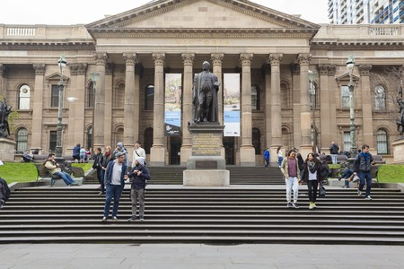 student travel: Melbourne, Australia - Aug 1, 2015: People outside State Library of Victoria in Melbourne, Australia