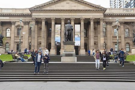 public library: Melbourne, Australia - Aug 1, 2015: People outside State Library of Victoria in Melbourne, Australia
