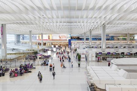 Hong Kong, China - Jun 23, 2015: Travellers in the departure hall of Hong Kong International Airport Terminal 2