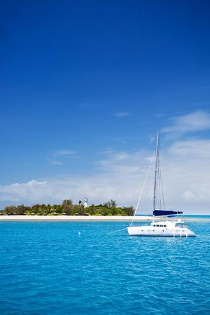 reef: Yacht near Low Isles at Great barrier reef, Australia