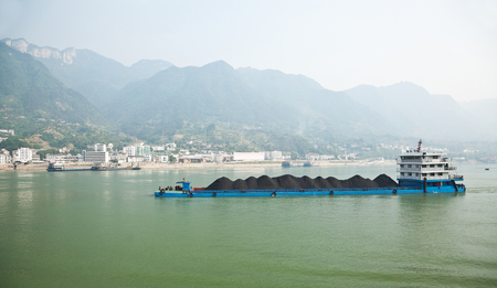 three gorges: Coal barge sailing along the Three gorges region of Yangtze river in China