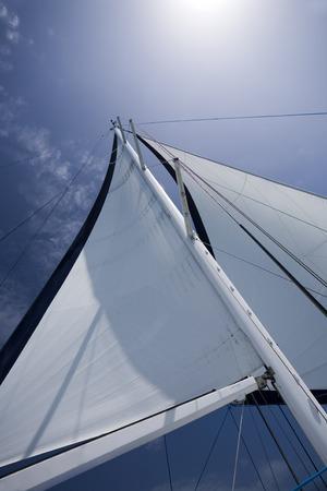 sail: Sail on a yacht against blue sky