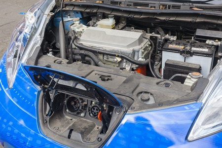 Charge port and motor unit under the hood of an electric car