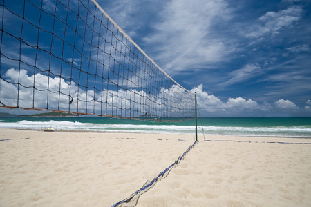 volleyball: Beach volleyball court and net against blue sky Stock Photo