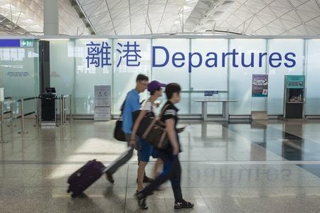 Hong Kong, China - June 12, 2015: People in the depature hall of Hong Kong International Airport