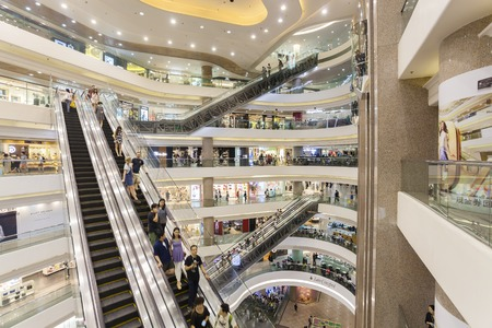 Hong Kong, China - June 7, 2015: People in a shopping mall in Hong Kong