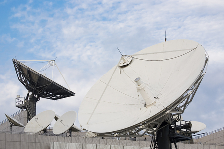 telecommunications: Satellite dishes used in telecommunication, against the sky