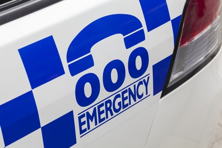 medical emergency service: Emergency number 000 in Australia on a police car Stock Photo