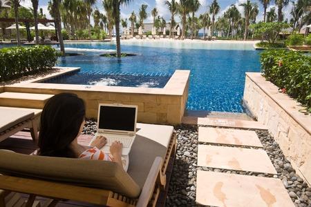 Using a laptop computer at hotel lagoon room