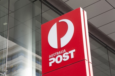 post: Melbourne, Australia - Auguest 28, 2015: Sign of Australia Post outside its office in Bourke Street, Melbourne Editorial