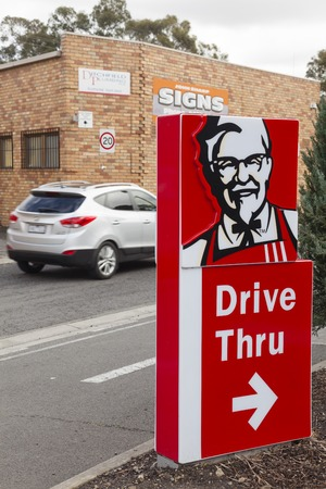 drive through: Melbourne, Australia - Auguest 29, 2015: Drive through sign outside a KFC store in Melbourne, Australia