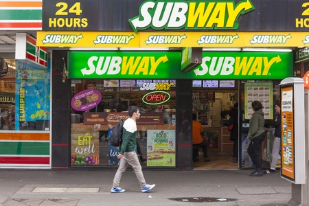 food stores: Melbourne, Australia - Auguest 29, 2015: People inside and walking past a Subway store in Melbourne, Australia