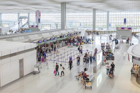 airport check in counter: Hong Kong, China - June 23, 2015: Travellers at the check-in counters of Hong Kong International Airport