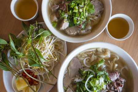 asian noodle: Vietnamese beef noodle soup for two with tea and bean sprout