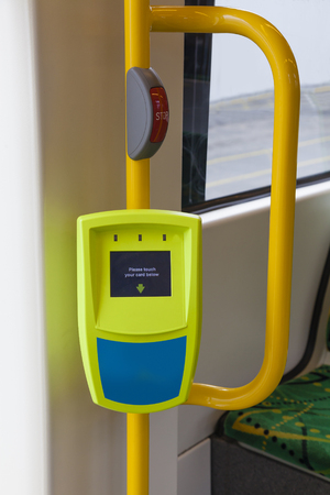 public transport: Clsoe-up view of ticket reader onboard a tram Stock Photo