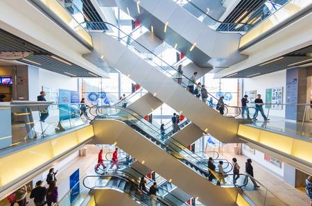 shopping mall: Hong Kong, China - Nov 19, 2013: People riding on escalators in a shopping mall in Hong Kong