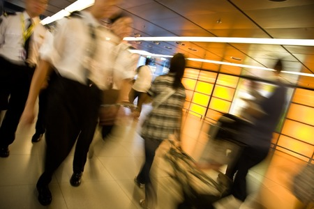 airport customs: Customs officers and travellers in an airport, strong motion blur Stock Photo