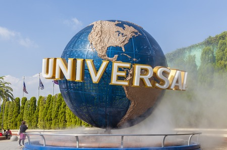 studios: Osaka, Japan - October 27, 2014: View of tourists and Universal Globe outside the Universal Studios Theme Park in Osaka, Japan. The theme park has many attractions based on the film industry.