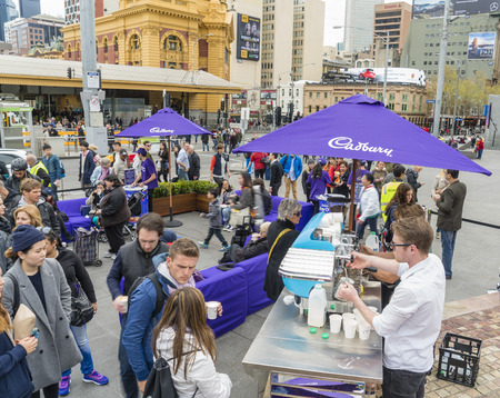 make public: Melbourne, Australia - Sep 18, 2015: People queuing up for free coffee in a public promotion event at Federation Square, Melbourne