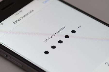 passcode: Melbourne, Australia - Sep 24, 2015: Enter passcode screen on an iPhone running iOS 9.  This new iOS release has six digits passcodes instead of four.