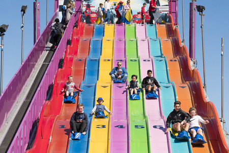 precinct: Melbourne, Australia - Sep 25, 2015: People enjoying a giant slide in the carnival precinct of the 2015 Royal Melbourne Show