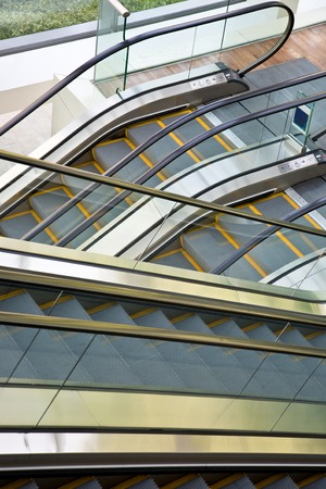 indoor inside: Close-up view of escalators in a modern office building