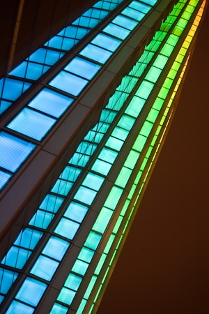 changing color: Close-up of a modern building with changing color lights