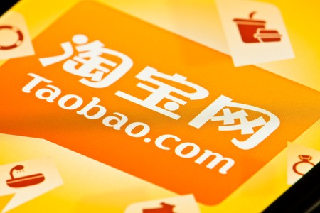 Hong Kong, China - Jul 2, 2011: Startup screen of Taobao app on an iPhone. Taobao is the largest Chinese language web site for online shopping, similar to eBay, Rakuten and Amazon. It is operated by Alibaba Group. Editoriali