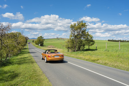 roofless: Car travelling on country road in wine region Stock Photo