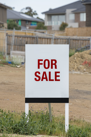 vacant: For sale sign on a vavant residential land