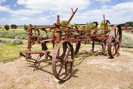 plough: View of an antique rusty plough in a farm Stock Photo