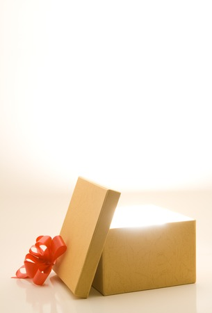 white boxes: Opened gift box with light and room for text