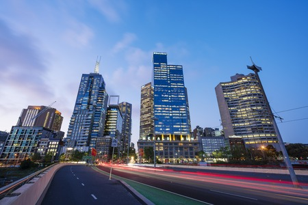office building: Melbourne, Australia - Oct 13, 2015: View of modern buildings and traffic trails in Melbourne CBD, Australia at night Editorial