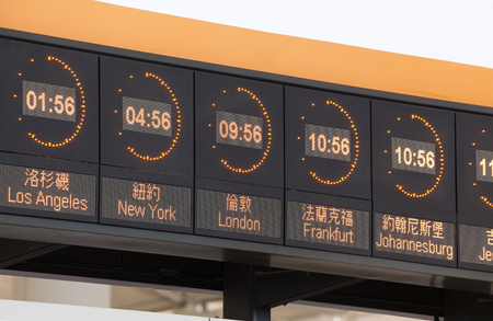 timezone: Clocks in an airport showing the time of different major cities