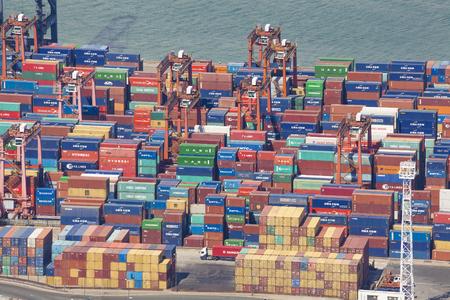 camion grua: Hong Kong, China - Jun 15, 2015: Container ship unloading at the Kwai Tsing Container Terminals in Hong Kong