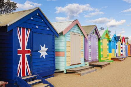 brighton beach: Bathing boxes in a beach against blue sky with copyspace