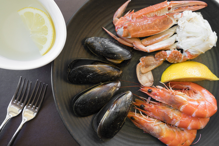 blue swimmer crab: Top down view of seafood on plate including prawns, mussels and crab Stock Photo