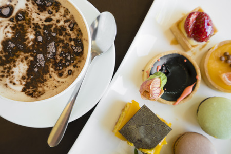 topdown: Variety of desserts and coffee, top-down view