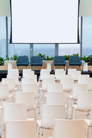 presentation screen: Empty seminar room with seats and projector screen